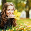 Stock Photo: Womat autumn outdoors