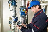 Heating engineer repairman in boiler room — Stock Photo