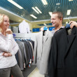 Young couple at clothes shopping — Stock Photo #7401739