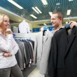 Young couple at clothes shopping — Stock Photo