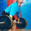 Stock Photo: Bodybuilder lifting weight at sport gym