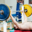 Bodybuilder lifting weight at sport gym — Stock Photo #7401941