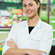 Pharmacy chemist woman in drugstore - ストック写真