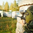 Paintball player under attack — Stock Photo #7402085