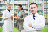 Confident pharmacy chemist man in drugstore — Stock Photo
