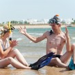 Couple at sea beach with snorkel set — Stock Photo #7461808