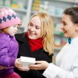 Pharmacy chemist, mother and child in drugstore - Stockfoto