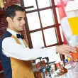Cheerful arab barman at counter — Stock Photo