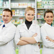 Pharmacy chemist team women and man in drugstore - 