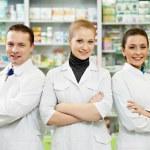 Pharmacy chemist team women and man in drugstore — Stock Photo