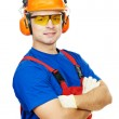 Постер, плакат: Builder in hard hat earmuffs and goggles