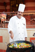 Arab chef frying meat on pan — Stock Photo