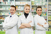 Pharmacy chemist team women and man in drugstore — Stock Photo