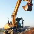 Wheel loader excavator - Stock Photo