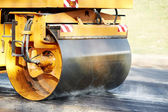 Compactor roller at asphalting work — Stockfoto