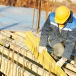 Construction worker preparing formwork - Stock Photo