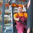 Warehouse worker driver in forklift — Stock Photo #7769756