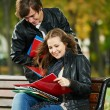 Stock Photo: Two smiling young students studying outdoors