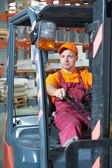 Warehouse worker driver in forklift — Foto de Stock