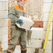 Bricklayer at construction masonry works — Stock Photo