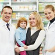 Pharmacy chemist, mother and child in drugstore - Stock Photo