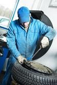 Machanic repairman at tyre fitting — Stock Photo