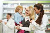 Pharmacy chemist, mother and child in drugstore — Stockfoto
