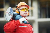 Builder worker at construction site — Foto Stock