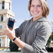 Young beautiful woman showing compact camera screen — Stock Photo