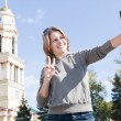 Royalty-Free Stock Photo: Young beautiful Russian woman photographing of himself