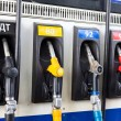 Refueling nozzle in gas station. Close up — Stock Photo