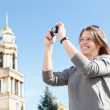 Young beautiful woman photographing — Stock Photo