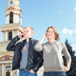 Young couple man and woman calling on mobile phone — Stock Photo