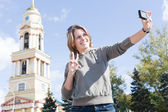 Young beautiful Russian woman photographing of himself — Stock Photo