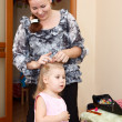 Mother plaits her daughters hair — Stock Photo