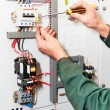 Electrician`s hands working with screwdriver — Stock Photo