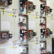 Stock Photo: Electric service panel with many switches