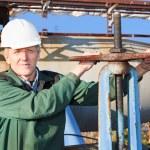 Manual worker turning big valve — Stock Photo #7582050