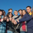 Happy College Students with Thumbs Up — Stock Photo