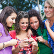 Female Teenagers Looking Photos in the Camera — Stockfoto
