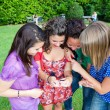 Female Teenagers Looking Photos in the Camera — Stockfoto #6939655