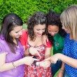Female Teenagers Looking Photos in the Camera — Stock Photo #6939660