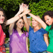 Teenage Female Friends with Hand in Stack — Stock Photo