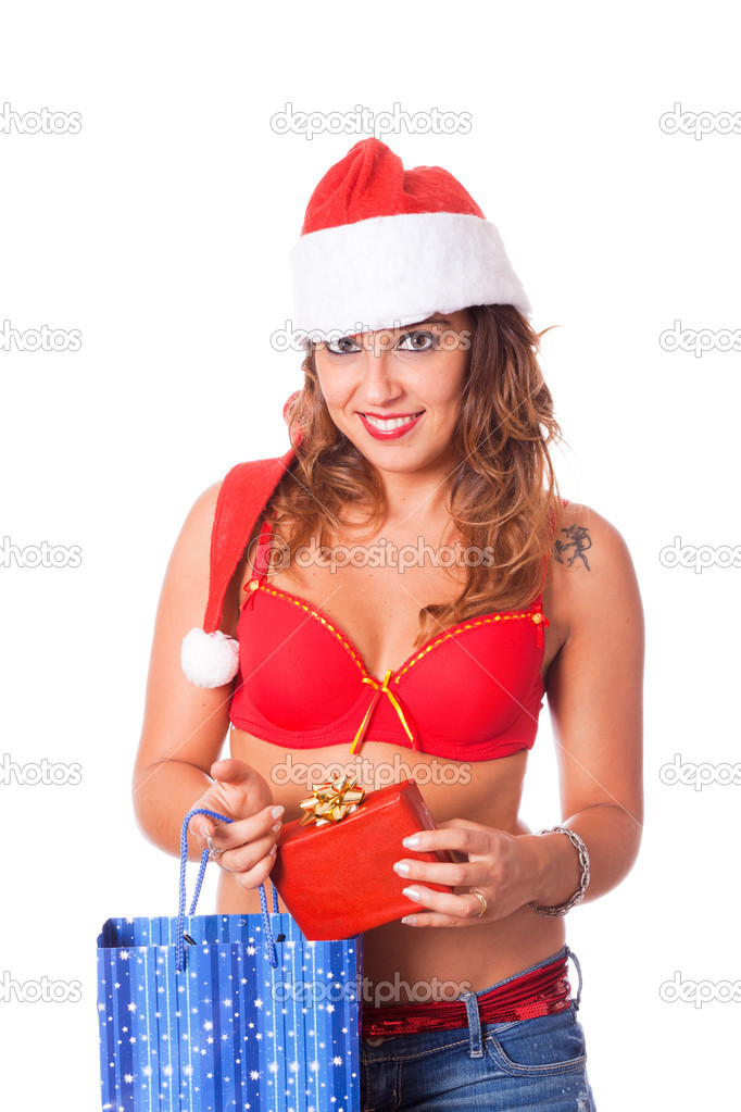 Sexy Woman with Santa Hat and Christmas Gift — Stock Photo #7211915