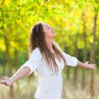Young Woman Outside with Open Arms, Freedom Sensation — Stock Photo