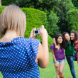 Girl Taking Photos to Her Friends — Stock Photo #7303463