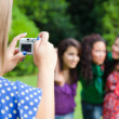 Girl Taking Photos to Her Friends — Stock Photo #7303467