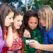 Female Teenagers Looking Photos in the Camera — Stock Photo #7303488