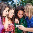 Stock Photo: Female Teenagers Looking Photos in the Camera