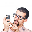 Young Doubtful Man Typing on Mobile — Stock Photo #7391453
